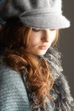Teenage Girl Wearing Cap And Knitwear In Studio Stock Images