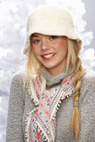 Teenage Girl Wearing Cap And Knitwear In Studio Stock Image