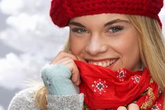 Teenage Girl Wearing Cap And Knitwear In Studio Royalty Free Stock Photos