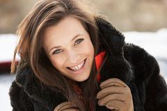 Teenage Girl Wearing Fur Coat In Snowy Landscape Stock Photos