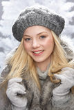 Teenage Girl Wearing Fur Coat In Studio Stock Image