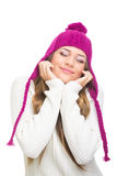 Teenage girl wearing pink hat daydreaming Stock Image