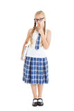 Teenage girl wearing a school uniform and glasses holding a laptop. Royalty Free Stock Images