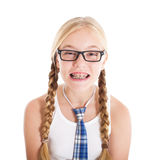 Teenage girl wearing a school uniform and glasses. Smiling face, braces on your teeth. Studio shot, isolated on a white background Stock Photo