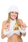 Teenage girl wearing white Christmas costume holding gift Royalty Free Stock Images
