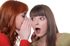 Teenage girl whispering Stock Photography