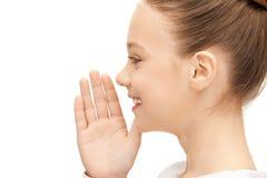Teenage girl whispering gossip Royalty Free Stock Image