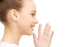 Teenage girl whispering gossip Royalty Free Stock Photography