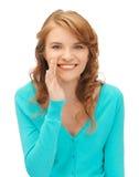 Teenage girl whispering gossip Royalty Free Stock Photos