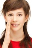 Teenage girl whispering gossip Stock Photos