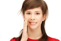 Teenage girl whispering gossip Royalty Free Stock Images