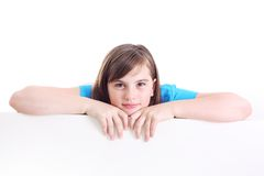 Teenage girl beside a white blank. Royalty Free Stock Photo