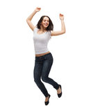 Teenage girl in white blank t-shirt jumping Royalty Free Stock Image
