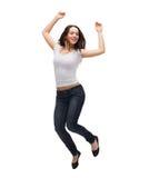 Teenage girl in white blank t-shirt jumping Royalty Free Stock Image
