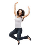 Teenage girl in white blank t-shirt jumping Stock Photos