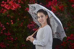 Teenage girl in white with colorful bougainvillea flowers Royalty Free Stock Photography