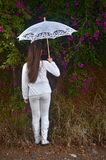 Teenage girl in white with colorful bougainvillea flowers Royalty Free Stock Images