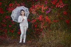 Teenage girl in white with colorful bougainvillea flowers Royalty Free Stock Photos