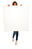 Teenage girl with white panel Royalty Free Stock Photos