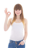 Teenage girl in white t-shirt showing ok sign isolated on white Royalty Free Stock Photos