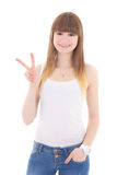 Teenage girl in white t-shirt showing victory sign isolated on w Royalty Free Stock Photos