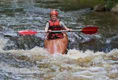 Teenage girl white water kayaking Royalty Free Stock Images