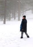 Teenage girl walking on snow Royalty Free Stock Photo