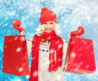 Teenage girl in winter clothes with shopping bags Stock Photos