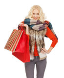 Teenage girl in winter clothes with shopping bags Royalty Free Stock Images