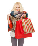 Teenage girl in winter clothes with shopping bags. Retail and sale concept - happy teenage girl in winter clothes with shopping bags Stock Images