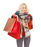 Teenage girl in winter clothes with shopping bags Stock Photo