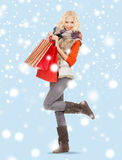 Teenage girl in winter clothes with shopping bags Royalty Free Stock Photography