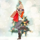 Teenage girl in winter clothes with shopping bags Royalty Free Stock Photos
