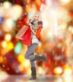 Teenage girl in winter clothes with shopping bags Stock Photography