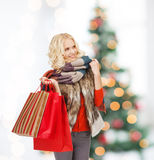 Teenage girl in winter clothes with shopping bags Royalty Free Stock Image