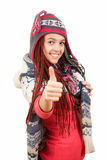 Teenage girl in winter clothes with thumb up Stock Image