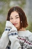 Teenage girl in the winter forest. Snowfall royalty free stock photos