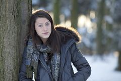 Teenage girl in winter woods Stock Images