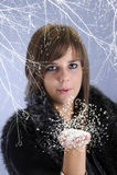 Teenage girl wlowing snow Royalty Free Stock Photos