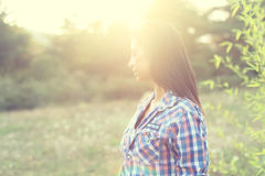 Teenage girl in the wood. During a sunny day royalty free stock image