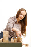 Teenage girl with wooden cubes Stock Images
