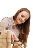 Teenage girl with wooden cubes Royalty Free Stock Photography