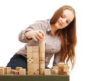 Teenage girl with wooden cubes Royalty Free Stock Image