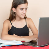 Teenage girl working on her computer at home Stock Photo