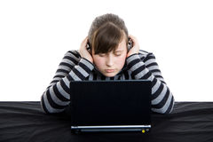 Teenage girl working with laptop. Young teenage girl working with laptop Stock Photo