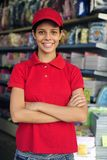 Teenage girl working in a stationery shop. Portrait of a teenage girl working part time in a stationery shop royalty free stock photography