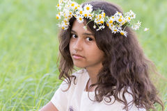 Teenage girl with a wreath of daisies on the Royalty Free Stock Images