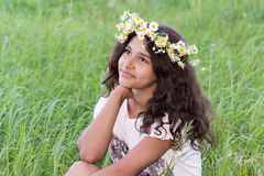 Teenage girl with a wreath of daisies on the Stock Photos