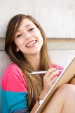 Teenage girl writing Stock Photos