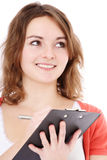 Teenage girl writing on clipboard Royalty Free Stock Images